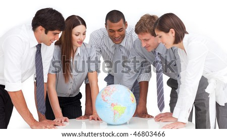 A meeting of business team around a terrestrial globe against a white background - stock photo