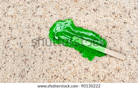 A melting Popsicle on carpet with stain protection. - stock photo