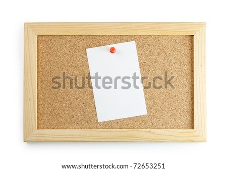 A memo sheet pinned to the center of a cork board with a red push pin. - stock photo