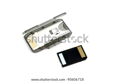 A memory card and the adapter on a white background