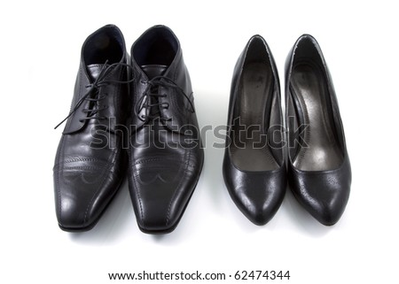 A men and lady shoes couple on a white background. - stock photo
