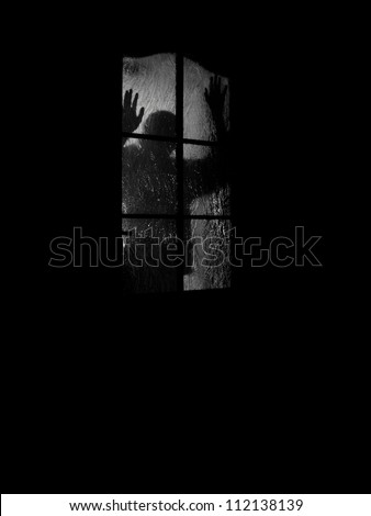 a men standing on the other side of the door - halloween or movie scen - stock photo