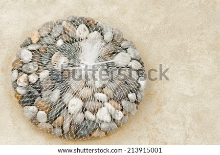 A mesh bag of small stones for landscaping or crafts