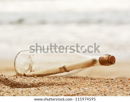 a Message in a bottle washed up on the beach, great business concept for snail mail, spam, or bad slow communication - stock photo