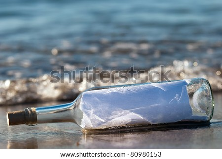 a message in a bottle with news in the surge - stock photo