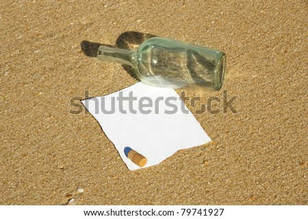 A Message note is found inside a bottle at the beach (Write your own text) - stock photo