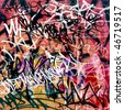 A Messy Graffiti Wall Background - stock vector