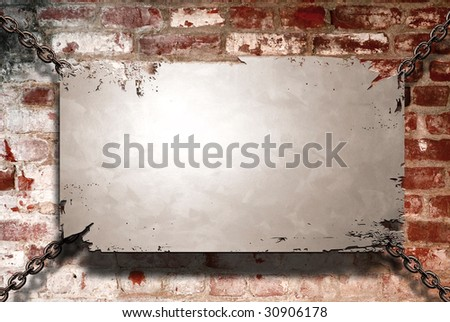 A metal banner held with chains on a brick wall - room for copy on the banner - stock photo
