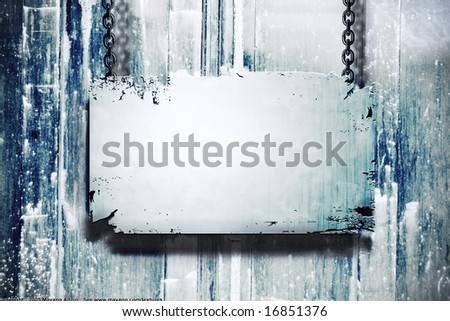 A metal banner held with chains on a grungy background - room for copy on the banner - stock photo