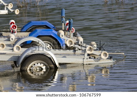 A metal boat trailer - stock photo