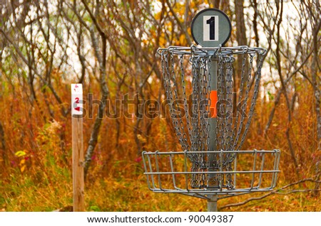 A Metal Disc Golf Catcher in Autumn - stock photo