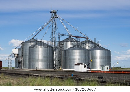 A metal grain facility with silos