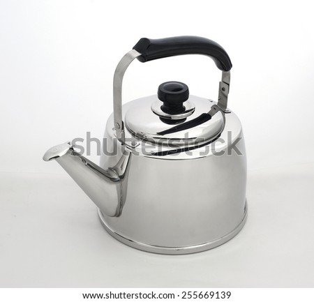 A metal kettle against a plain background - stock photo