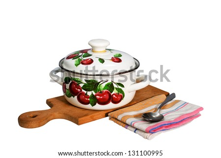 a metal pan and kitchen utensils on a cutting board. - stock photo