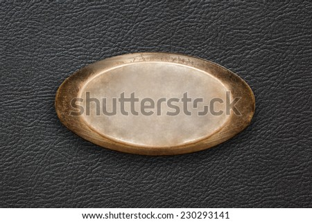 A metal plate on a background of the skin - stock photo