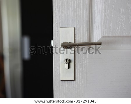 a metallic knob on door horizontal - stock photo