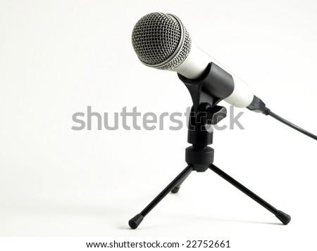A metallic microphone on white background - stock photo