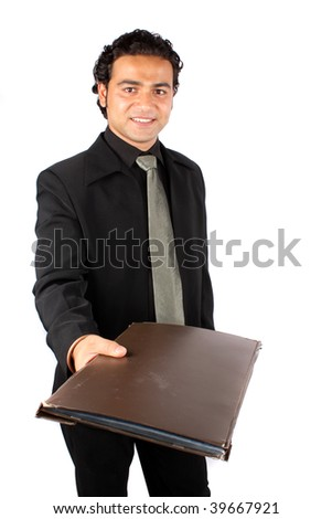 A metaphorical image of a happy Indian businessman handing over the file of a successful project, on white studio background. - stock photo