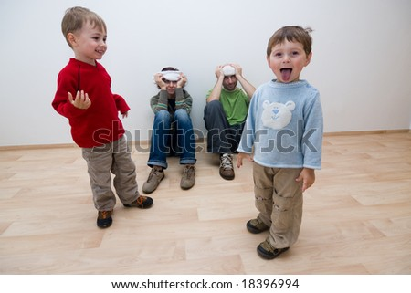 A metaphorical image showing naughty kids troubling their parents who are already fed-up with their tricks.