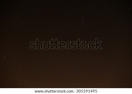 A Meteor captured during the 2015 Perseids Meteor Shower from Kineton, Gloucestershire countryside under clear starry skies. - stock photo