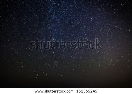 A meteor streaks the sky in Malta during the 2013 Perseid showers - stock photo