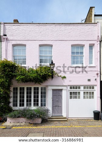 A mews house converted from an eighteenth century stable carriage building, in Kensington, London, UK. - stock photo