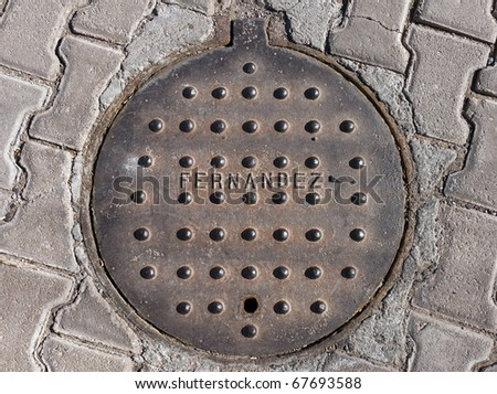A Mexican manhole cover in San Carlos, Mexico - stock photo