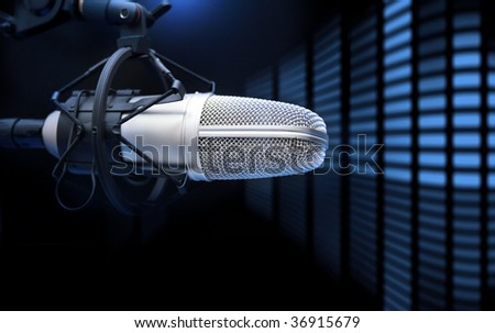 A mic in front of the sound analyzer / music concept - stock photo
