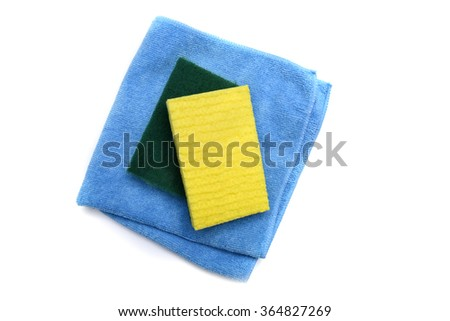 A microfiber cloth and scrubbing sponges from an overhead view - stock photo