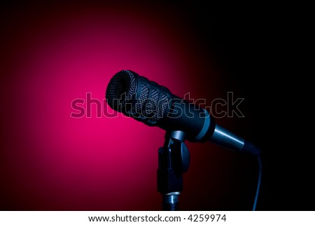 A Microphone In A Red Spotlight - stock photo