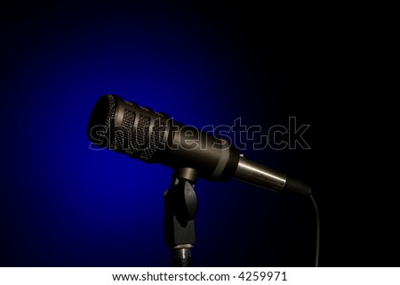 A Microphone In Blue Spotlight - stock photo