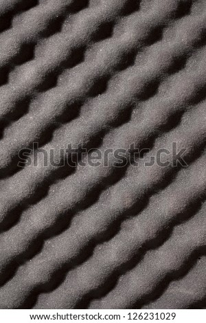 A microphone is shown alone with a blurred background. - stock photo