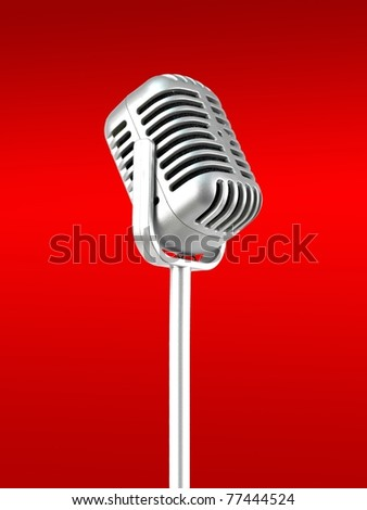 A microphone isolated against a red background - stock photo