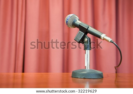 A microphone on a red background - stock photo