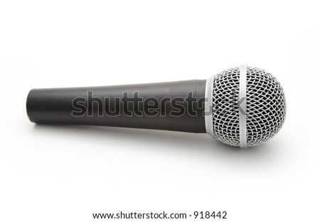 A microphone on a white background. - stock photo