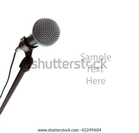A microphone on the stand on a white background with copy space - stock photo