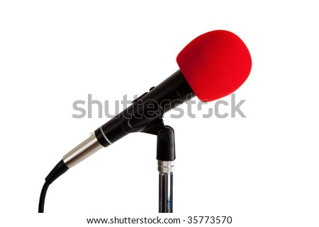 A microphone with red foam windscreen on a white background with copy space - stock photo