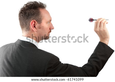 A mid thirties business man side on, throwing a dart.  The man is wearing a suit and tie and has spiky hair and a goatee beard.  Studio isolated on a white background. - stock photo