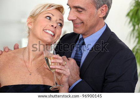 A middle age couple celebrating. - stock photo