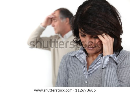 A middle age couple having a fight. - stock photo