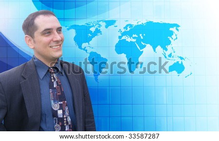 A middle aged business man is looking to the future with a blue background. He is looking at a map of the Earth and has a vision. - stock photo