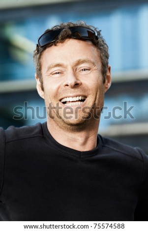 A middle aged man expressing happiness - stock photo