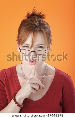 A Middle aged Silencing Woman wearing Spectacles - stock photo