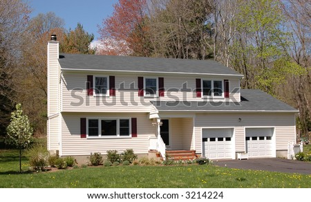 A middle-class colonial house on a sunny day - stock photo