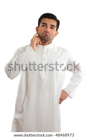 A middle eastern dressed man wearing a kurta, robe, thobe, is looking quite worried and troubled. - stock photo