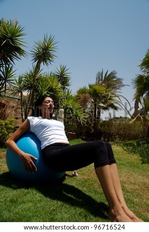 A middle eastern female training in the garden - stock photo
