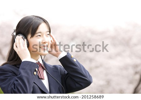 A middle school girl listening to music with headphones on