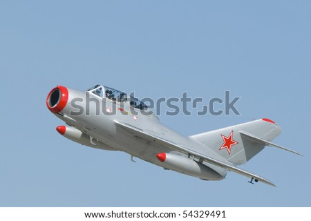 A Mikoyan-Gurevich MiG-15 two-seater jet fighter with Soviet markings. The MiG-15 was developed for the USSR  by Artem Mikoyan and Mikhail Gurevich. - stock photo
