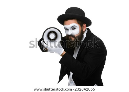 A mime as business man with a megaphone isolated on a white background. conceptual idea - to kill the word - stock photo