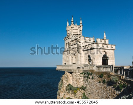 "A miniature castle on a rock in the Crimea called ""Swallow's Nest"". The fortress on the cliff above the sea."